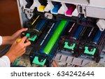 closeup of a woman fixing a... | Shutterstock . vector #634242644