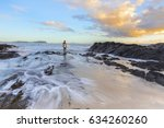 surfer standing at the end of... | Shutterstock . vector #634260260