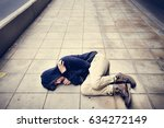 young asian male lying on the... | Shutterstock . vector #634272149