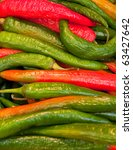 Red and green hot peppers ideal for backgrounds - stock photo