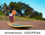 little baby boy   young surfer... | Shutterstock . vector #634299266
