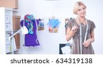 young fashion designer working... | Shutterstock . vector #634319138