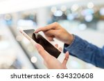 woman working on cellphone | Shutterstock . vector #634320608