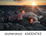 black lava field with hot red... | Shutterstock . vector #634324763