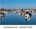 boats moored in newport beach... | Shutterstock . vector #634327490