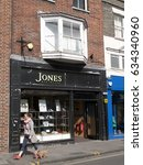 Small photo of High Street, Salisbury, Wiltshire, England - May 5, 2017: Jones Bootmaker shop, founded in 1857 by Alfred and Emma Jones