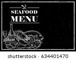 hand drawn seafood on a chalk...   Shutterstock .eps vector #634401470