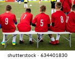 youth sport soccer team sitting ... | Shutterstock . vector #634401830
