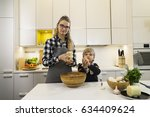 happy young mother and son... | Shutterstock . vector #634409624