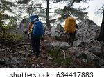 hikers walking in mountains | Shutterstock . vector #634417883