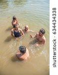 Small photo of People having bath in river, rural village Zidke, Bhiwandi, Thane, Maharashtra, India, Southeast Asia.