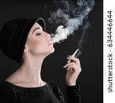 young fashion woman smoking...   Shutterstock . vector #634446644