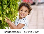 happy mixed race toddler girl  | Shutterstock . vector #634453424