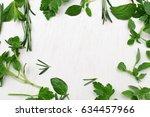 green fresh herbs mix on white... | Shutterstock . vector #634457966