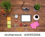 hipster work space on wooden... | Shutterstock . vector #634502006