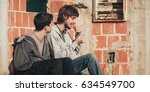 two man smoke cannabis or... | Shutterstock . vector #634549700