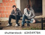 two depressed and sad young... | Shutterstock . vector #634549784