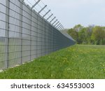 security fence of an... | Shutterstock . vector #634553003