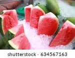 Small photo of Fresh red watermelon freeze with ice in the glass box. This fruit is popular fruit for summer. Trinomial name is Citrullus lanatus.