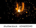 magic glowing flow of sparks in ... | Shutterstock . vector #634600340
