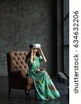 woman wearing virtual reality... | Shutterstock . vector #634632206