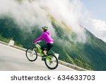 young woman cycling | Shutterstock . vector #634633703