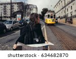 female traveler holding and... | Shutterstock . vector #634682870