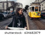 female traveler holding and... | Shutterstock . vector #634682879