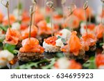 the buffet at the reception.... | Shutterstock . vector #634695923