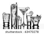 five vodka drinks on glass surface with reflection, white background - stock photo