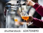 pouring beer in a glass   Shutterstock . vector #634704890