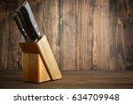 knifes in wooden block on...   Shutterstock . vector #634709948