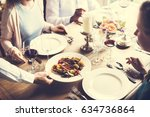 restaurant staff serving food...   Shutterstock . vector #634736864