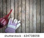 gardening gloves and watering... | Shutterstock . vector #634738058