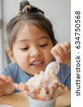 a little girl eating yummy ... | Shutterstock . vector #634750568