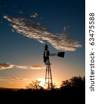 Silhouette Of A Windmill At...