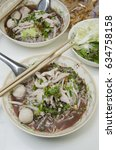Small photo of Fine Cut White Rice Noodle thicken soup with pork ball on white table.