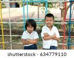 Small photo of Poor Asian children smiling in school uniform in poor school waiting help from rich people