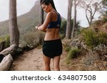 female runner checking fitness... | Shutterstock . vector #634807508