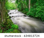 smooth and silky river with... | Shutterstock . vector #634813724
