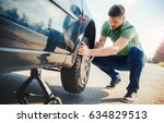 man changing wheel after a car... | Shutterstock . vector #634829513
