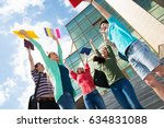 happy students jumping for joy... | Shutterstock . vector #634831088