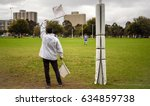 a goal umpire waves two white...   Shutterstock . vector #634859738