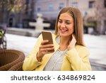 beautiful young female using...   Shutterstock . vector #634869824