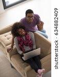 happy young african american... | Shutterstock . vector #634882409