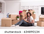 relaxing in new house. cheerful ... | Shutterstock . vector #634890134