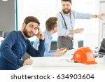 handsome bearded man looking... | Shutterstock . vector #634903604