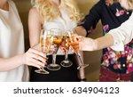 hands holding the glasses of...   Shutterstock . vector #634904123