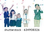 group of kids celebrating in a... | Shutterstock . vector #634908326