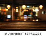 image of wooden table in front... | Shutterstock . vector #634911236